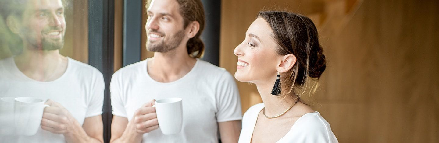 Couple enjoying coffee while gazing out window