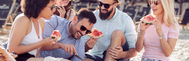 Group enjoying watermelon at a picnic