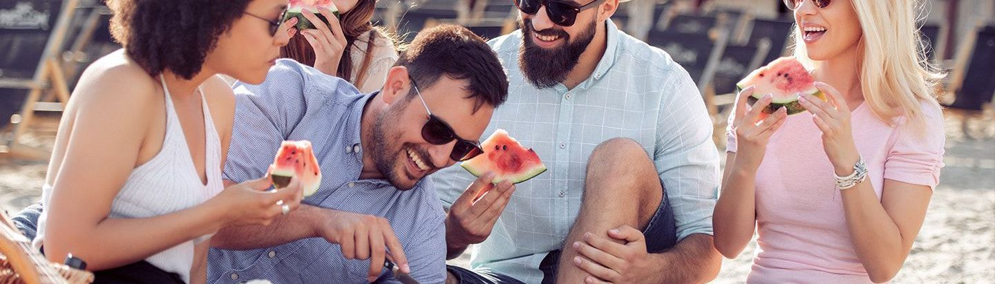 Group enjoying watermelon at a picnic