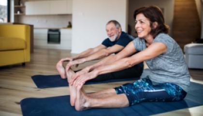 Woman and man doing yoga