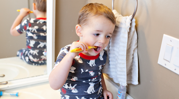 Young boy brushing teeth.