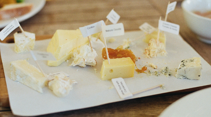 Different types of cheese on a plate.